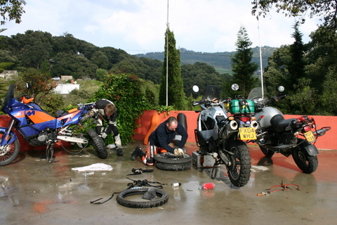 Trip report: Morocco 2007. Changing tyres in the South of Spain - Motomorgana, nomads riding around the world on a motorbike adventure.